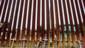 Nogales, Mexico: Memorial crosses beside a border wall