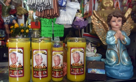 Candles with pictures of Amlo sold in a market in the Mexican city of Villahermosa, his hometown, on 22 June 2018.
