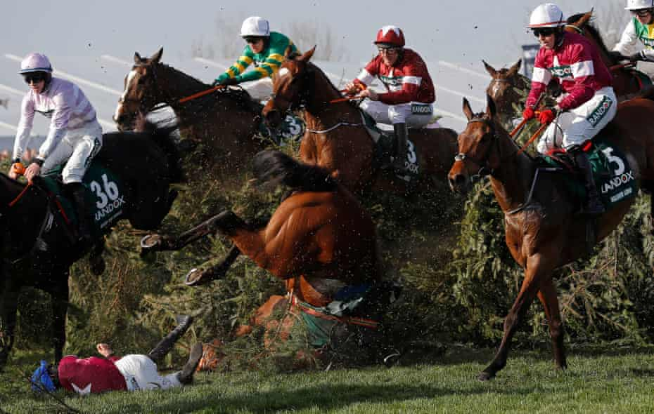 Rachael Blackmore falls off Alpha des Obeaux at the Chair fence just in front of eventual winner Tiger Roll during the Grand National on day three of the Grand National meeting at Aintree Racecourse in April 2018