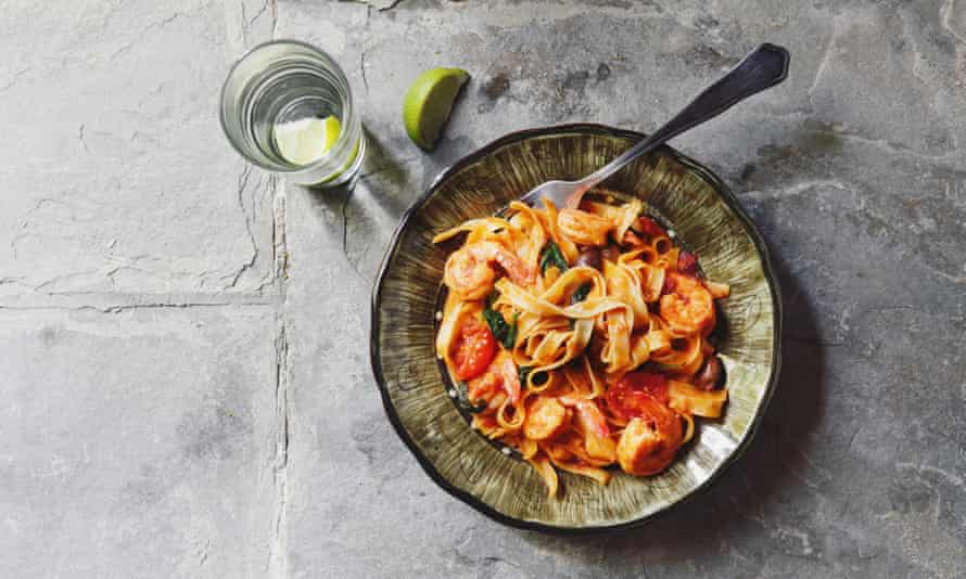 Linguine with tomato sauce and prawns.
