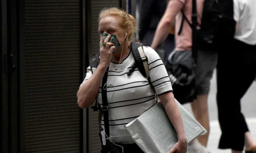 A woman wears a mask in Sydney