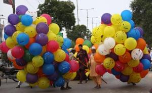 Men sell balloons for the festivities