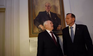 John Howard and then prime minister tony Abbott in front of a portrait of Robert Menzies in Canberra in 2014