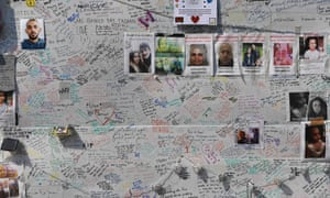 Wall of picture of those lost in Grenfell Tower
