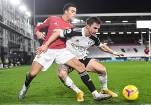 Joe Bryan of Fulham tussles with Mason Greenwood of Manchester United.