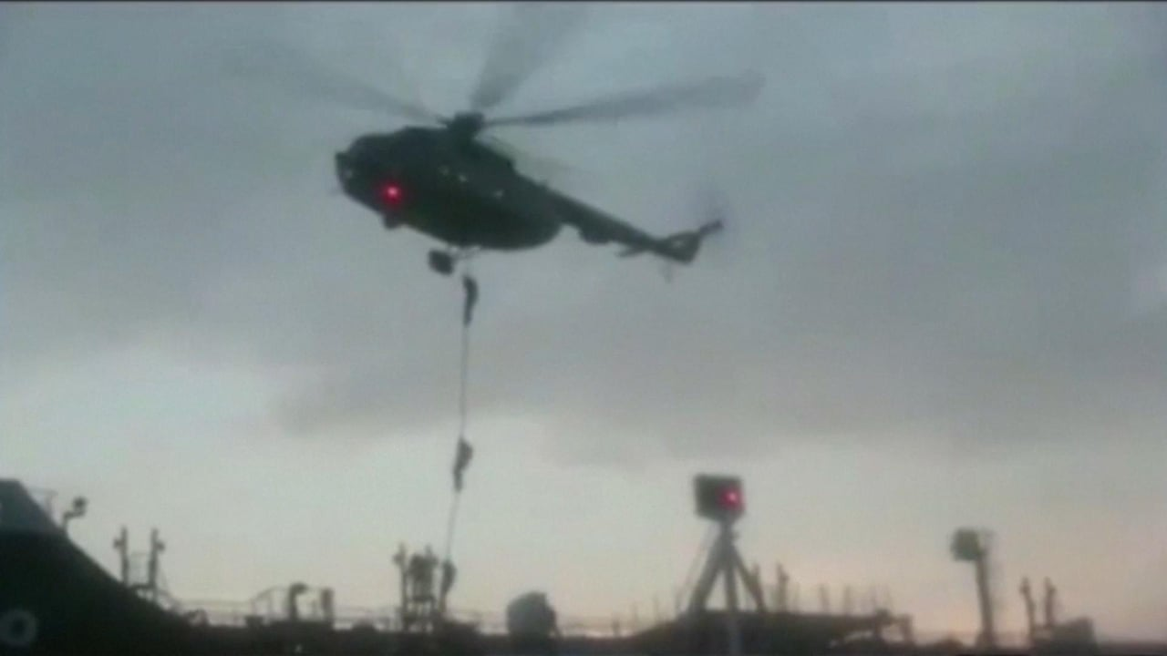 Iran troops rappel on to seized British-flagged oil tanker – video