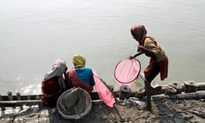 Girls catch fish on the banks of the Ganges in India.