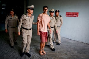 Hakeem al-Araibi's legs are shackled as he is escorted by Thai prison officers after Monday's extradition hearing