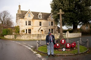RAF Veteran Alan McQuillin observes the two minute silence at a war memorial by his home in Cirencester in Gloucestershire