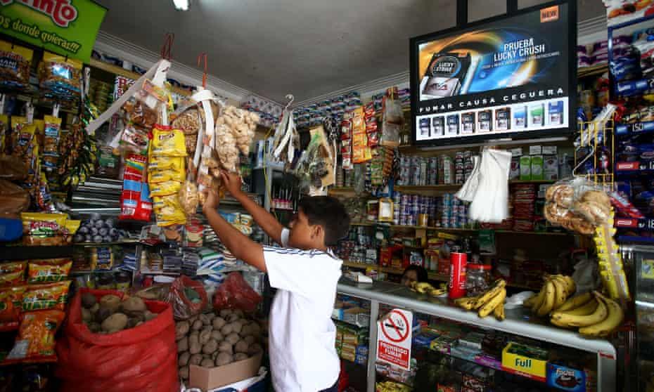 Lucky Strike advertised inside a bodega in Lima, Peru. smoking starts on average at age 14 in Peru.
