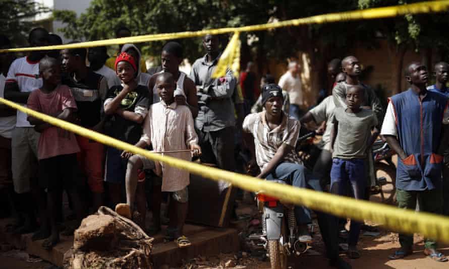 Children behind a police barricade outside the Radisson Blu hotel in Bamako, Mali, on 21 November.