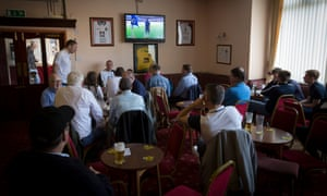 Marine supporters gather at the club bar, officially known as the Graham Lounge, before the match against Ilkeston on 19 September