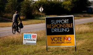 Road signs in Texas illustrate both sides of the fracking debate. The industry creates jobs but environmentalists and others have voiced concerns.