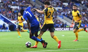 Ahmed Musa of Leicester City is taken down by Hector Bellerin of Arsenal