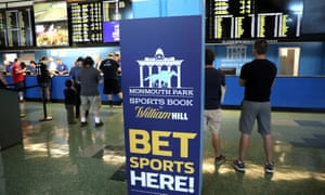 Gamblers place bets on sports at Monmouth Park Sports Book by William Hill in Oceanport, New Jersey