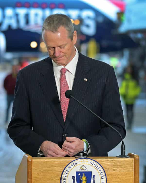 Massachusetts governor Charlie Baker speaks to the press on Thursday in front of a plane that delivered masks from China.