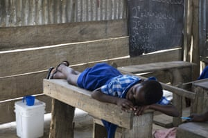 A student sleeps at the only school in the farming community of Apprah. Most students at school are malnourished, and many fall asleep during the day or have problems concentrating in class