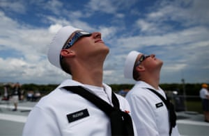 Two sailors staring up