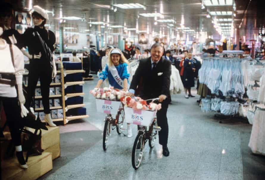 Sir Terence Conran rides through a BHS store.