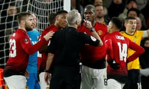 Manchester United players protest with referee Martin Atkinson.