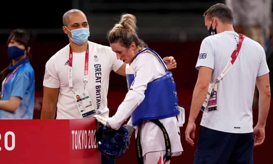 Jade Jones is comforted by members of her team after losing against Kimia Alizadeh.