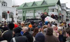 People protest in front of the Progressive Party headquarters building in Reykjavik on April 5.