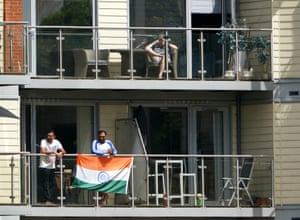 Fans in the surrounding apartments watch the action.