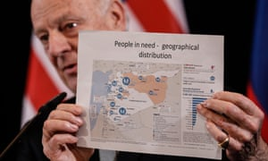 Steffan de Mistura, the UN secretary general's special envoy, holds up a map showing people in need in Syria.