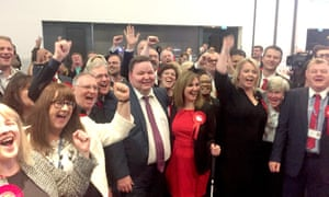 Labour councillors in Trafford celebrate after the Conservatives lost overall control.
