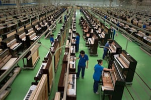 The main factory floor of the Beijing Xinghai Piano Group Ltd, where up to 30,000 pianos are made a year.