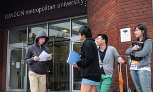 Foreign students outside a campus of the London Metropolitan University.
