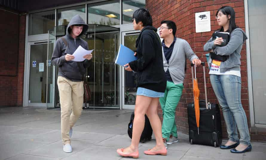 Foreign students pictured outside a campus of the London Metropolitan University.