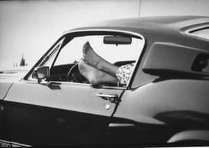 Spectator's feet protruding out of driver's-side window while waiting for take-off of the moon-landing mission, Apollo 11, at Cape Kennedy