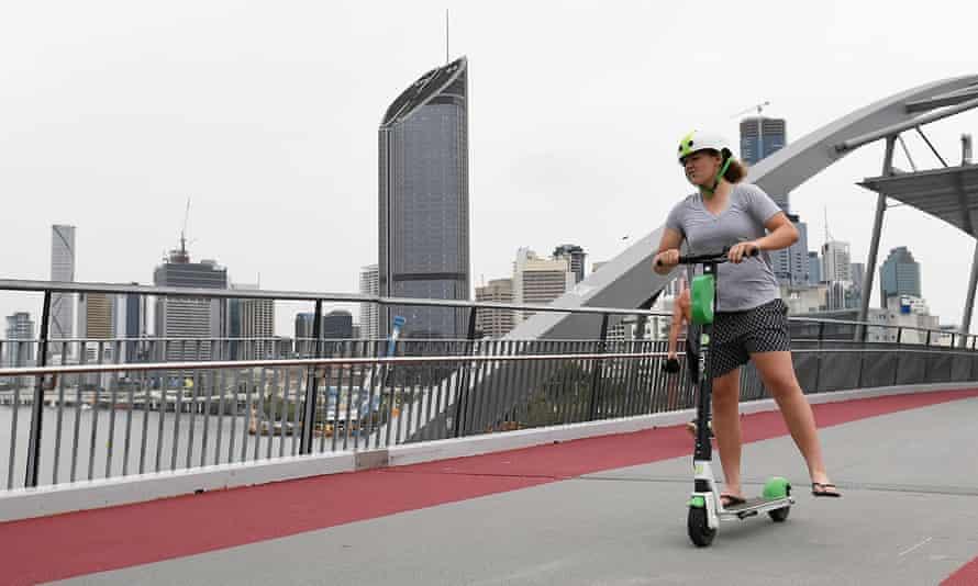 An e-scooter rider crosses the Goodwin Bridge in Brisbane.