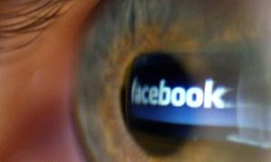 Facebook logo seen reflected in a person's eye