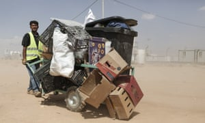 Muhammed Abu Najib Temeki, 48, a father of nine from Deraa in Syria pushes a cart of recyclable waste