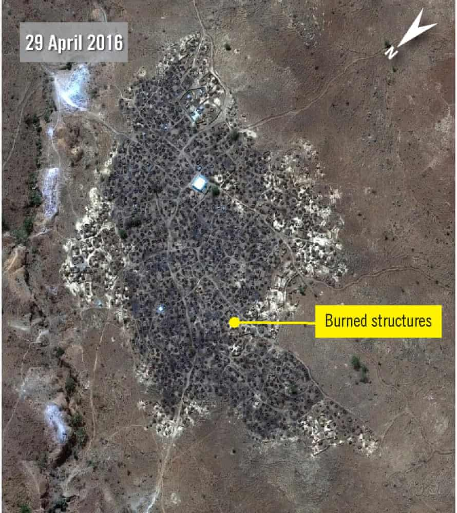 Satellite photographs showing that Karmal village has been almost completely razed by fire.