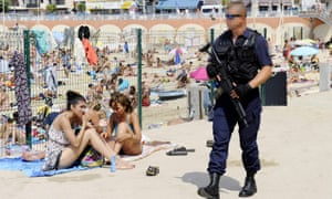 A French policeman patrols at the Catalans beach in Marseille