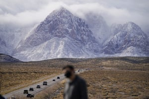 People look at mountains recently covered with snow at the Red Rock national conservation area near Las Vegas.