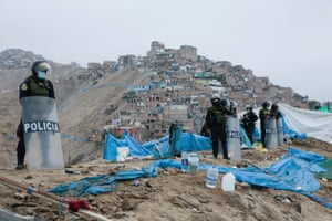 Chorrillos, PeruRiot police officers keep watch near makeshift tents occupying the land on Morro Solar, considered a protected area and where building houses are not allowed, during an operation to evict people