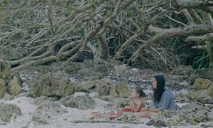 Poh Lin Lee and one of her children in a still from Island of the Hungry Ghosts