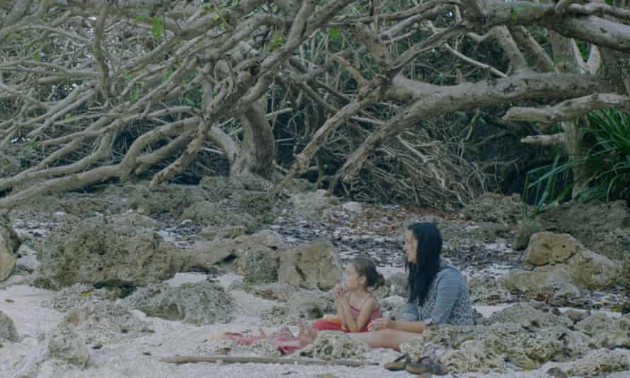 Trauma counsellor Poh Lin Lee with her daughter in The Island of Hungry Ghosts.