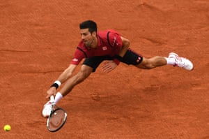 Djokovic hits a backhand.