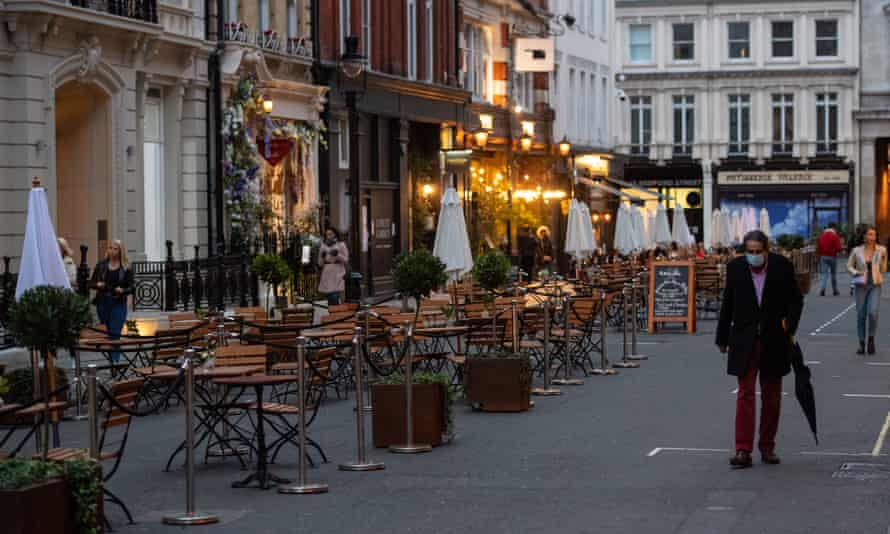 Rows of empty tables outside a restaurant in Covent Garden, central London, a day after the city was put into tier 2 restrictions to curb the spread of coronavirus.