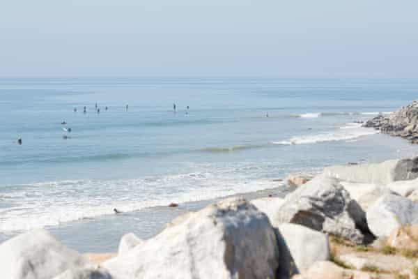 Surfers at Sunset beach, Malibu, California.