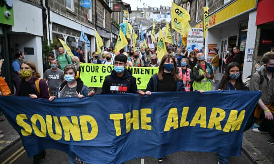 Extinction Rebellion activists take part in the 'Sound The Alarm' march during the G7 summit in Cornwall