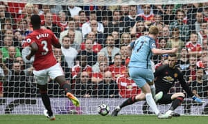 Manchester City's Kevin De Bruyne sends Manchester United lkeeper David de Gea the wrong way as he slots the ball home.
