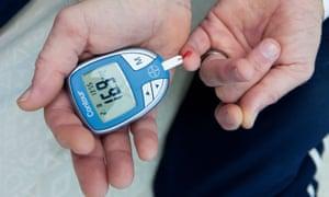 A man tests his blood sugar level