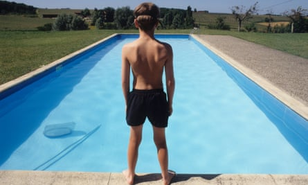 A young boy at a swimming pool.