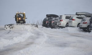 Snow machines clear the car park at Guthega